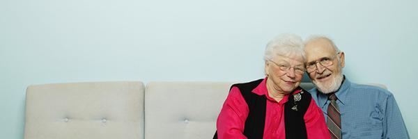 Loving Senior Couple on Sofa