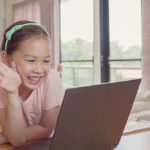 Girl waving at grandparents - guide to using Zoom for seniors